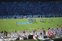 UNC Tarheels vs NC State Wolfpack. Tarheels vs Wolfpack November 17, 2010 - view is from NC State side of stadium, game is at UNC - team is breaking from huddle Royalty Free Stock Photo