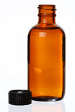 Uncapped Generic Medicine Bottle. Isolated Generic Brown Glass Bottle, Cap Off, Against White, Bit of Reflection royalty free stock photo