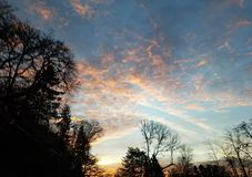Unceasing Daybreak. A sunrise so beautiful you have to get triple glances with it& x27;s blues and oranges Stock Photo