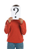 Uncertain African Man. Young Man With Question Mark Signboard Isolated On White Background Royalty Free Stock Photo