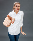 Uncertain beautiful young woman hesitating for stressful defense or accusation. Uncertain beautiful young woman hesitating at pointing her big index to the Stock Images