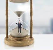 Uncertain businessman hourglass Stock Photography