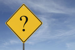 Uncertain Future. A warning sign with a question mark on a blue sky backgroundrn Stock Photos
