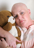 Uncertain Future. A medical patient hugging a teddy bear and looking afraid Royalty Free Stock Photos