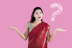 Uncertain Indian woman with question sign Royalty Free Stock Photography