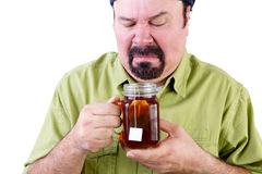 Uncertain middle aged man with healthy cup of tea Stock Photography