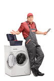 Uncertain plumber gesturing with hands Royalty Free Stock Images