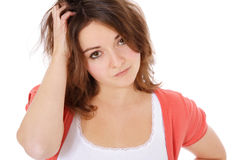 Uncertain teenage girl. Portrait of an uncertain teenage girl. All on white background royalty free stock photo