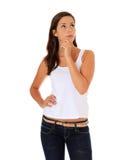 Uncertain teenage girl deliberates decision Stock Images