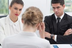 Uncertain woman on interview. Uncertain stressed women during her job interview Stock Images