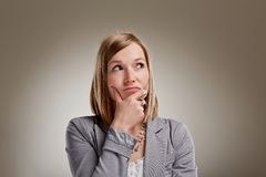 Uncertain young blond woman Stock Photography