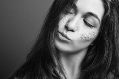 Uncertain young woman portrait evaluation decision. Black and white portrait. Uncertain young woman. Evaluation and decision. Female with pursed pout lips stock photo