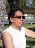 Uncertainty. Filipino middle aged man wearing sunglasses looking far ahead Stock Photography
