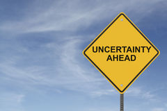 "Uncertainty Ahead. ""Uncertainty Ahead"" sign with a  background of blue sky with light cloudsrn Stock Photo"