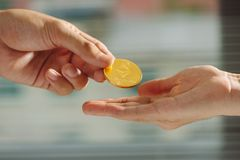 Uncertainty with bitcoin in hand,war of bitcoin,pull bitcoin wit. H hand to hand, many bitcoins up,on bokeh,white,blue,purple light background, bitcoins in Royalty Free Stock Photos
