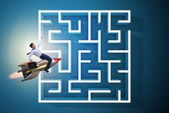 The uncertainty concept with businessman lost in maze labyrinth. Uncertainty concept with businessman lost in maze labyrinth Stock Photography