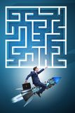 The uncertainty concept with businessman lost in maze labyrinth. Uncertainty concept with businessman lost in maze labyrinth Royalty Free Stock Photo
