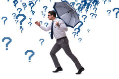 The uncertainty concept with businessman and question marks Stock Photos