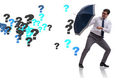 The uncertainty concept with businessman and question marks Stock Images