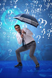 The uncertainty concept with businessman and question marks. Uncertainty concept with businessman and question marks Royalty Free Stock Image
