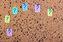 uncertainty or doubt concept, question mark on a sticky note on cork bulletin board Stock Image