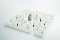 The uncertainty of money and business. Dollar banknotes hidden inside a maze Stock Photography