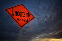Uncertainty warning road sign. With storm background Stock Photos