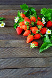 Unch of ripe strawberries on dark boards. Food Royalty Free Stock Images