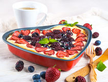 Вunch of wild berries. Fruit pudding with berries and fresh mint Stock Photo