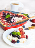 Вunch of wild berries. Fruit pudding with berries and fresh mint Stock Photos