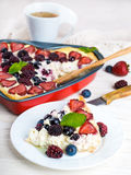 Вunch of wild berries and mint. Fruit pudding with berries and fresh mint Stock Photography