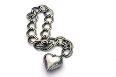 Unchain my heart. Tarnished silver heart on chain isolated over white Stock Photography