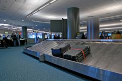 The Unclaimed. Unclaimed baggage on an airport carousel in an international arrival area stock photo