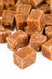 Unclarified organic brown cane sugar cube Stock Photos
