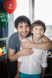 Uncle, nephew embrace on holiday royalty free stock images