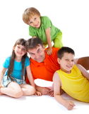 Uncle with nephews and niece Royalty Free Stock Photo