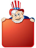 Uncle Sam. Holding a blank sign for your text Stock Photography