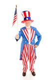 Uncle Sam with American Flag. American icon Uncle Sam holding a US flag. Full body isolated royalty free stock image