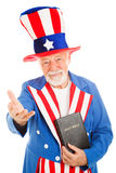Uncle Sam With Bible - Welcoming. American icon Uncle Sam holding a bible and making a welcoming gesture. Isolated on white royalty free stock images