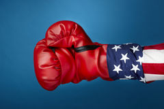 Uncle Sam with boxing gloves. Close up shot of Uncle Sam wearing red boxing glove includes space for copy royalty free stock image