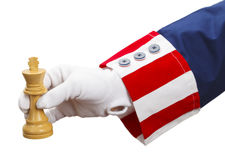 Uncle Sam Check Mate. President Playing Chess with King Isolated on White Background Royalty Free Stock Photo