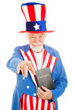 Uncle Sam - Church and State. American icon Uncle Sam holding a bible and pointing at you. Isolated on white royalty free stock photography
