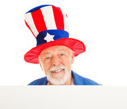 Uncle Sam Head - Happy. American icon Uncle Sam design element. Isolated head peering over white board stock images