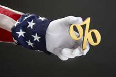 Uncle Sam holding percent sign. Close up shot of Uncle Sam holding a percent symbol stock photo