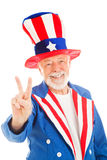 Uncle Sam - Peace Sign. American icon Uncle Sam giving the peace sign. Isolated stock images