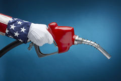 Uncle Sam pumping gas. Close up shot of Uncle Sam holding gas nozzle with space for copy royalty free stock images