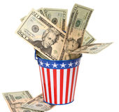 Uncle Sam's Collection Pail. Twenty-dollar bills stuffed into a stars-and-stripes decorated pail. Concept of American money going to the government in taxes Royalty Free Stock Photos