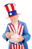 Uncle Sam Saving Money. Realistic Uncle Sam saving money in his piggy bank. Metaphor for American economy. Isolated stock photo