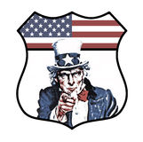 Uncle Sam. An original vintage halftone image section of Uncle Sam incorporating the U.S.A. flag in a shield badge design stock image
