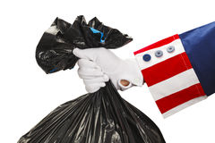 Uncle Sam Taking Out Trash Royalty Free Stock Image